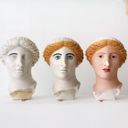 Researchers demonstrate the process of applying color to the Treu Head, from a Roman sculpture of a goddess, made in the second century A.D. Ancient sculptures were often painted with vibrant hair colors and skin tones.  Photograph by Mark Peckmezian for The New Yorker