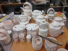 Pottery in varies stages of completion