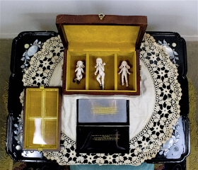 "Yana Bondar, Book 1: I Don't Quite Remember Anymore, 2018, book set in wooden box with porcelain figures, display is 16"" x 24"", box 11"" x 7"" x 4"""
