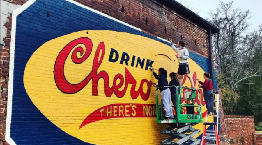 UGA students restore a vintage Chero-Cola sign at Oconee Brewing Company in Greensboro, Georgia.