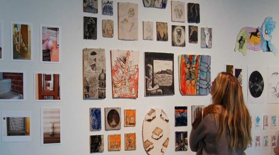 A student looks at work in a gallery