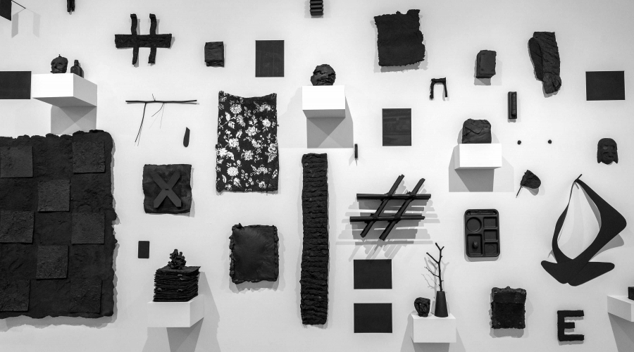 An exhibit where a bunch of everyday objects are painted black